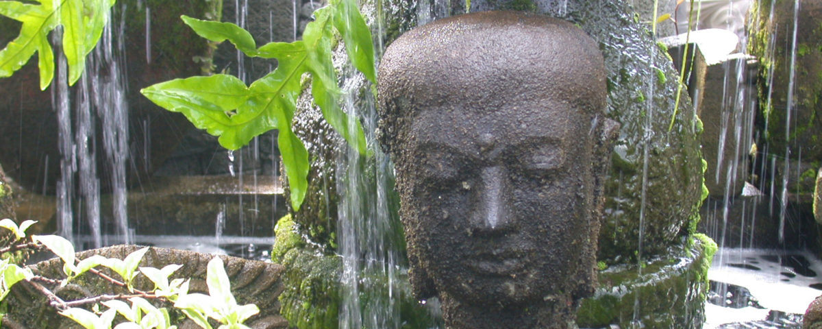 buddha fountain in a garden