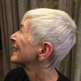 Elegant short haircut for a woman with gray hair